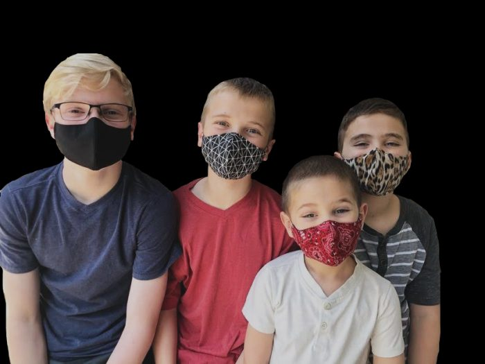 Picture showing boys wearing face masks in different sizes